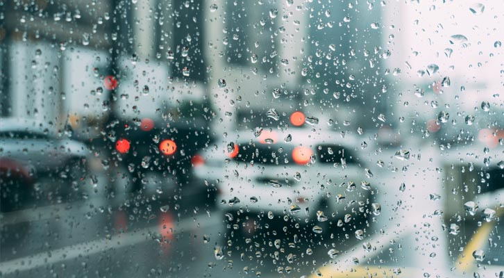 Cars on road in rain