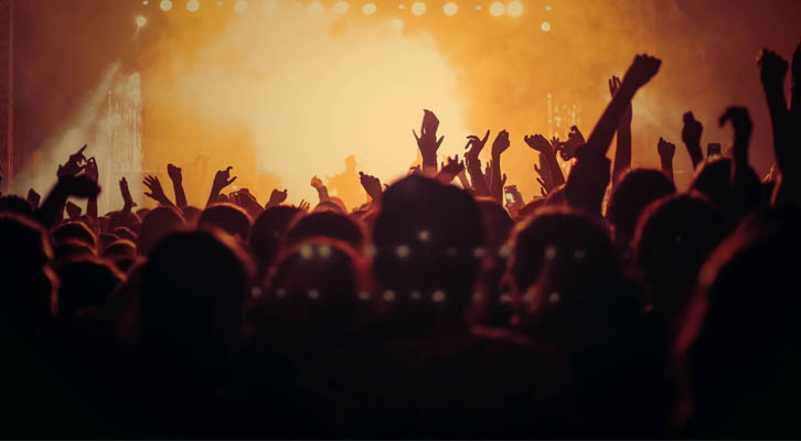 People at a concert in front of stage