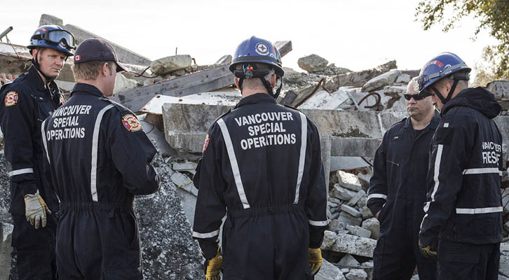 Vancouver Special Operations crew looking at concrete rubble