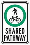 Sign of a person walking and a bicycle for shared pathways