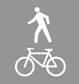 Pavement marking of a person walking and a bicycle for shared pathways