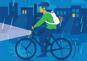Graphic of person riding a bicycle at night in the rain