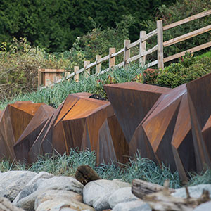 Metamorphous retaining wall
