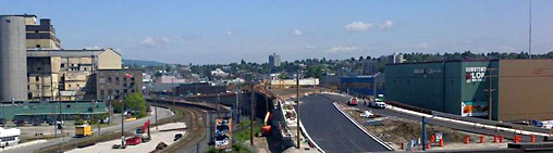 Road crews paving the western side of the Powell Street Overpass