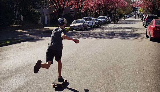 Young boy skateboarding in Vancouver