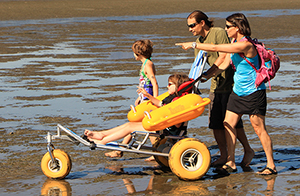 9 year-old Mia and family enjoying new water wheelchair at Spanish Banks