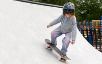 A young skateboarder on a halfpipe