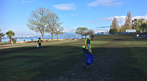 Park Board staff cleaning up the field at Sunset Beach Park after the 4/20 marijuana event
