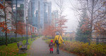 Mother and child walk along seawall in Vancouver