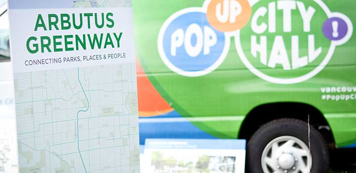 Arbutus Greenway map on board in front of Pop-Up City Hall cube van