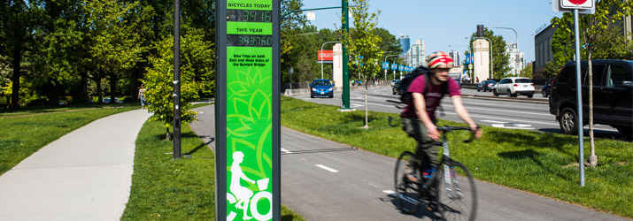 Man on bicycle on separated cycling lane in Vancouver