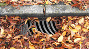 One way to prevent flooding is to keep storm drains clear of leaves and debris.