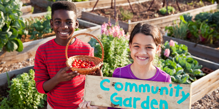 Two children in a community garden.