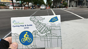 Person holding bike map