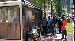 Customers lining up to eat at a food truck