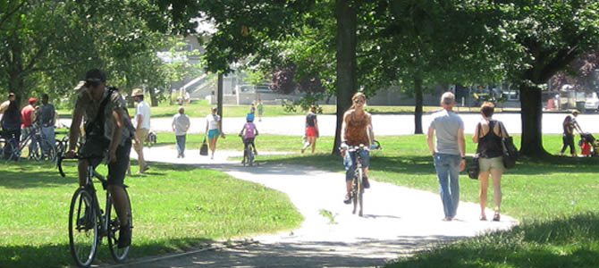 People walking and cycling in John Hendry Park