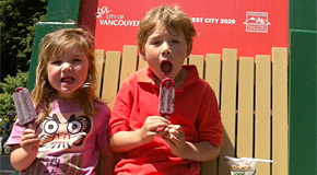 Kids eating locally-made popsicles at a park concession stand