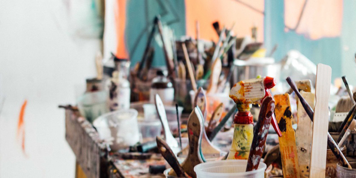 Artist work table with brushes
