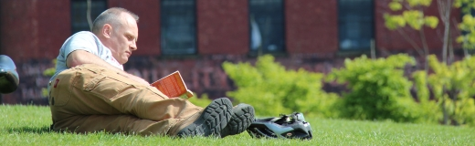 Man reading in the grass