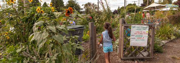 Girl enters community garden in Vancouver, Greenest City