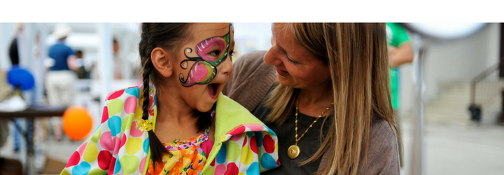 Child with butterfly face painting