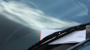Parking ticket on car windshield