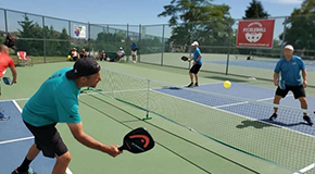 People playing pickleball on a pickleball court