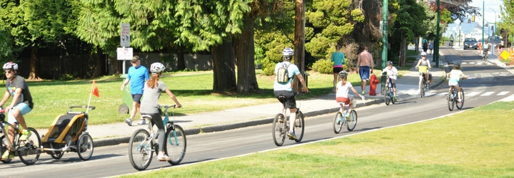 People cycling on the protected bike lane near Point Grey Road at Macdonald Street