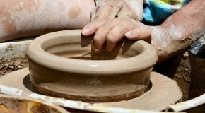 potter working on a pottery wheel
