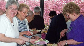 Senior women at a outdoor buffet