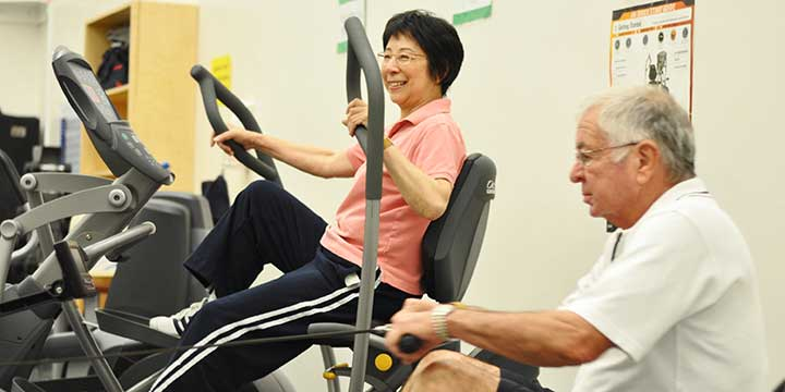 Two seniors exercising at a Park Board facility