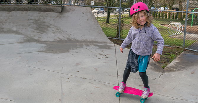 Child skateboarding in a skateboard park