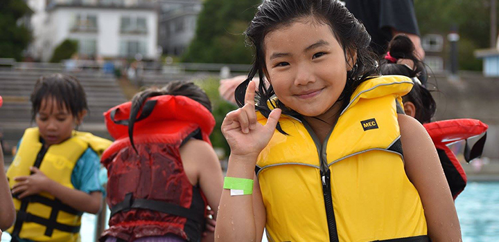 Child wearing a life jacket