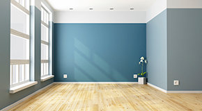 Vacant apartment with blue walls and no furniture