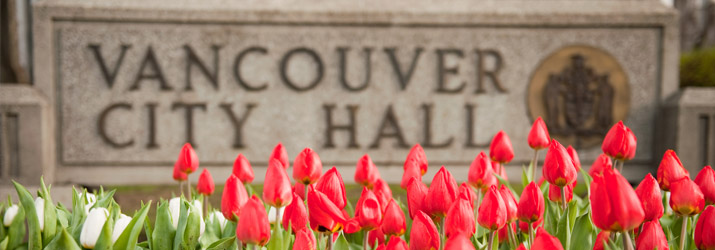Vancouver City Hall sign with tulips