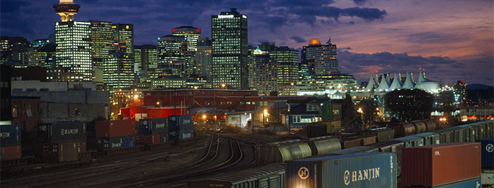 View of a CN train and Vancouver at night
