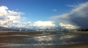 Clouds and sunny skies over Vancouver and Burrard Inlet, looking from Spanish Banks