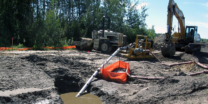 A pump removes contaminated water from a construction site to discharge into a sanitary sewer