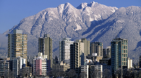 West end of vancouver with snow capped mountains