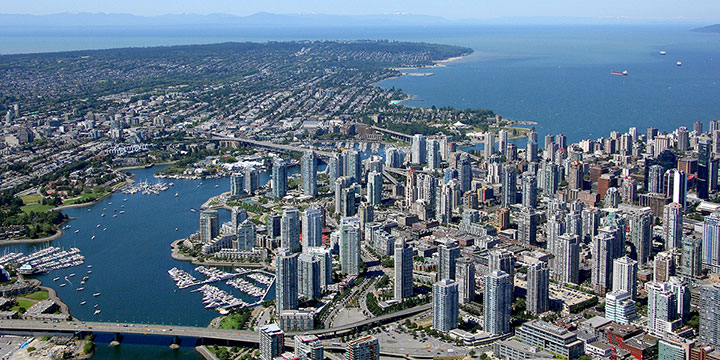 Aerial view of Yaletown and False Creek looking west towards Kitsilano, West Point Grey, and UBC