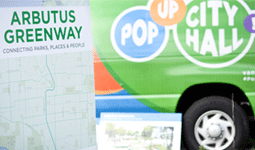 Arbutus Greenway map on board in front of a Pop-Up City Hall cube van