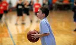 boy plays basketball