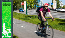 Man on bicycle on separated bike lane in Vancouver