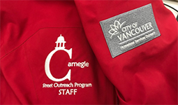 Close-up of a Carnegie Street Outreach staff jacket