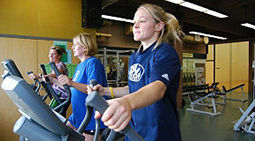 Exercise on an elliptical trainer at Champlain Heights Fitness Centre