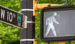Crosswalk walk signal at West 10th Ave