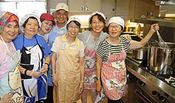 Volunteers in a soup kitchen