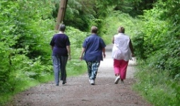 Women walking down a trail