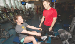Work with a personal trainer to reach your fitness goals
