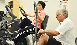 Two senior citizens exercising at a Park Board facility